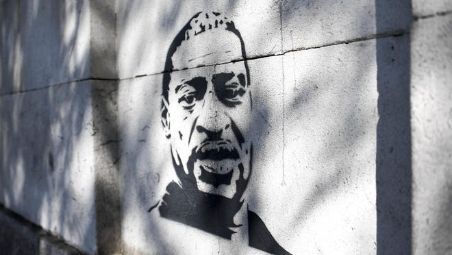 The face of George Floyd is sprayed on a wall, in London, Sunday, July 12, 2020, in the wake of the killing of George Floyd by police officers in Minneapolis, USA last month.
