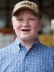 12-year-old Nick Aprill recreates his winning rooster