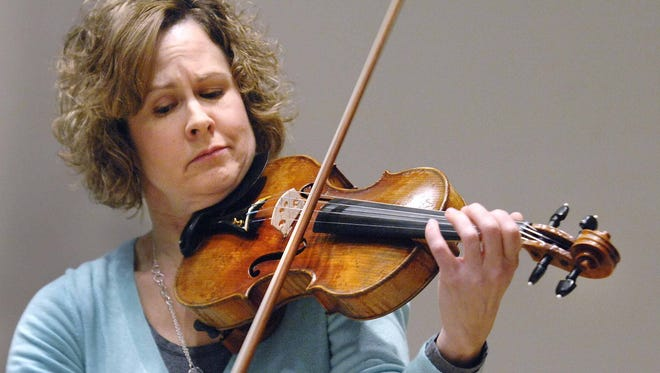 Sarah Gentry, professor of violin at Illinois State University,  plays a 250-year-old violin.