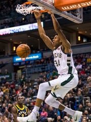 Jan 3, 2018; Milwaukee, WI, USA; Milwaukee Bucks forward Giannis Antetokounmpo (34) dunks during the first quarter against the Indiana Pacers at BMO Harris Bradley Center. Mandatory Credit: Jeff Hanisch-USA TODAY Sports