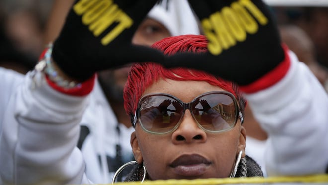 Lesley McSpadden, mother of police shooting victim Michael Brown, helps lead the Justice For All rally and march against police brutality and the killing of unarmed black men, in Washington, D.C.