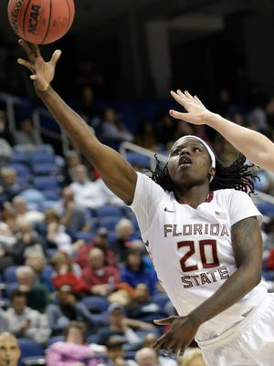 Florida State's Shakayla Thomas, a Sylacauga native, drives past Miami's Emese Hof (21) during the second half of an NCAA college basketball game in the Atlantic Coast Conference tournament in Greensboro, N.C., Friday, March 4, 2016. Miami won 74-56. (AP Photo/Chuck Burton)
