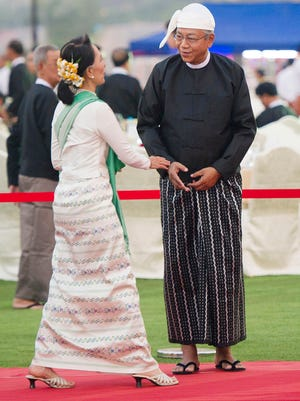 National League for Democracy leader Aung San Suu Kyi, left, is welcomed by new Myanmar President Htin Kyaw during a dinner reception in Naypyitaw, Myanmar, Wednesday, March 30, 2016.