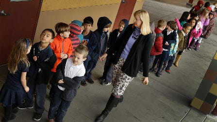 First grade teacher Lynda Jensen walks with her class of 30 children at Willow Glenn Elementary School in San Jose, Calif. The Common Core State Standards have been adopted by 45 states and the District of Columbia. Many parents still don't know what the standards are.