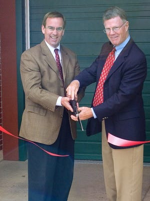 Arctic League buildilng committee Chairman Charlie Streeter, right, and then-board President Hank Kimball cut the ribbon to open the new Arctic League headquarters on West Clinton Street in Elmira in 2007. Streeter, a longtime Elmira business and community leader, died recently.