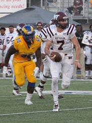 West Texas A&M quarterback Justin Houghtaling (7) tries