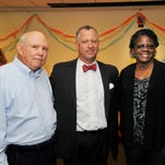 Former and present employees were honored Monday at a party celebrating FLORIDA TODAY's 50th anniversary. Jeff Kiel, president and publisher, is pictured with Nick White, left, and Clarene Malcom, right. White and Malcom worked at the newspaper when it debuted in 1966.