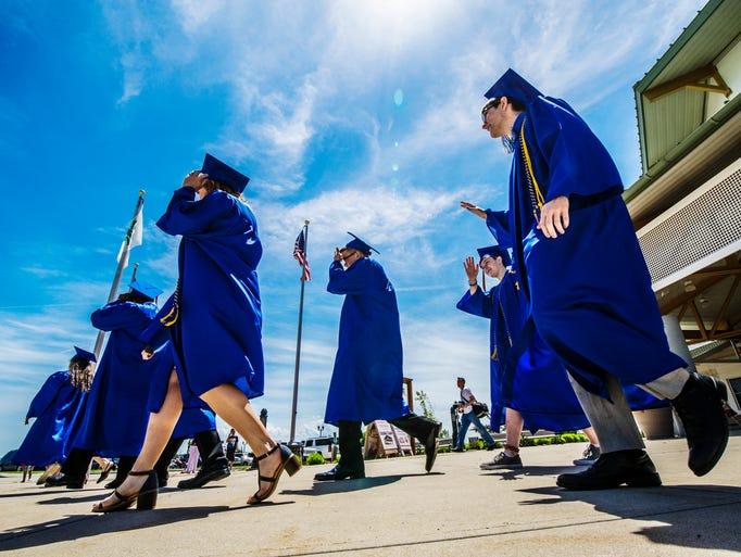 Graduating seniors of Germantown High School make their