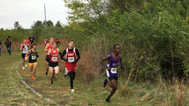 Topeka West sophomore Lenny Njoroge leads the pack in last Saturday's Class 5A boys regional cross country race at the Kanza Park Course.