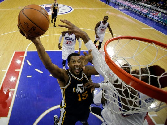 Utah Jazz's Derrick Favors goes up to shoot against Philadelphia 76ers' Nerlens Noel during the second half Friday in Philadelphia.