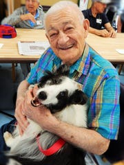 Joseph Fontana shares a smile with Gavin the therapy dog at Christian Health Care Center's Adult Day Services of Wayne. Gavin will be taking over Polly's therapy work.