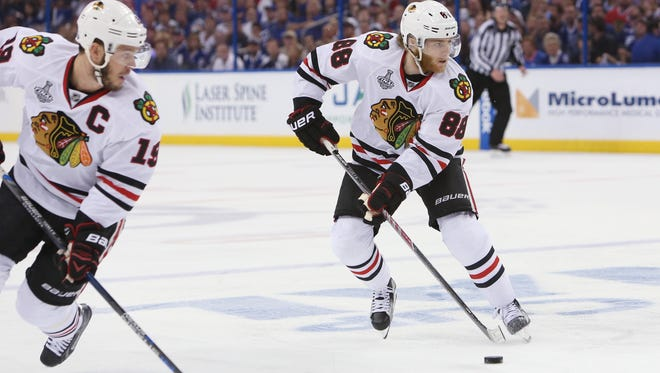 Jonathan Toews, left, and Patrick Kane, right, didn't score a goal in the first two games of the series.