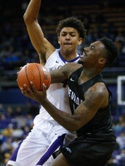 Wolf Pack guard Marcus Marshall drives past Huskies forward Matisse Thybulle for the game-winning basket Sunday.