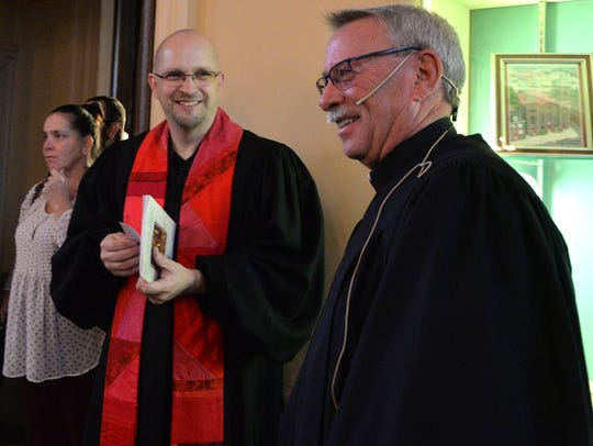 On left, Rev. David Long, incoming pastor of St. John's