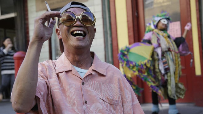 In this 2014 file photo, Suki Lam laughs while taking a smoke break in an alleyway in Chinatown in San Francisco.