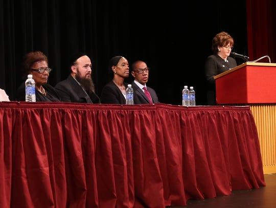 Commissioner MaryEllen Elia, right, announced former