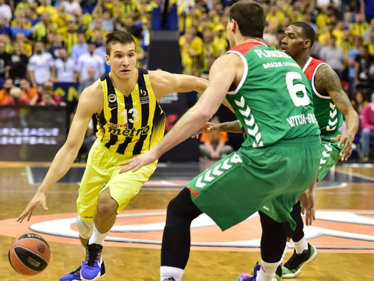 Istanbul's Bogdan Bogdanovic dribbles past Laboral's Kim Tillie during Sunday's semi-final at the Euroleague Final Four in Berlin on May 13, 2016.