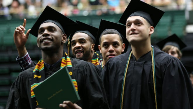 CSU basketball players, from left, Tiel Daniels, Stanton Kidd, Daniel Bejarano and J.J. Avila received their bachelor's degrees during a graduation ceremony May 16 at Moby Arena.