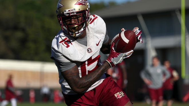 FSU's Tamorrion Terry runs with a pass during spring practice at the Al Dunlap Training Facility on Wednesday, March 21, 2018.