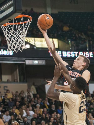 Dec 31, 2014; Winston-Salem, NC, USA; Princeton Tigers forward Hans Brase (30) goes up for a shot against Wake Forest Demon Deacons forward Cornelius Hudson (25) during the second half at Lawrence Joel Veterans Memorial Coliseum. Wake defeated Princeton 80-66.