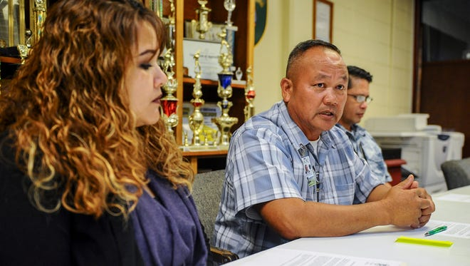 Department of Corrections Director Jose San Agustin, center, explains the preliminary results of an ongoing internal investigation at a press conference at DOC in Mangilao on May 27. Nine corrections officers were place on administrative leave after a detainee's escape went unnoticed for days, San Agustin said.