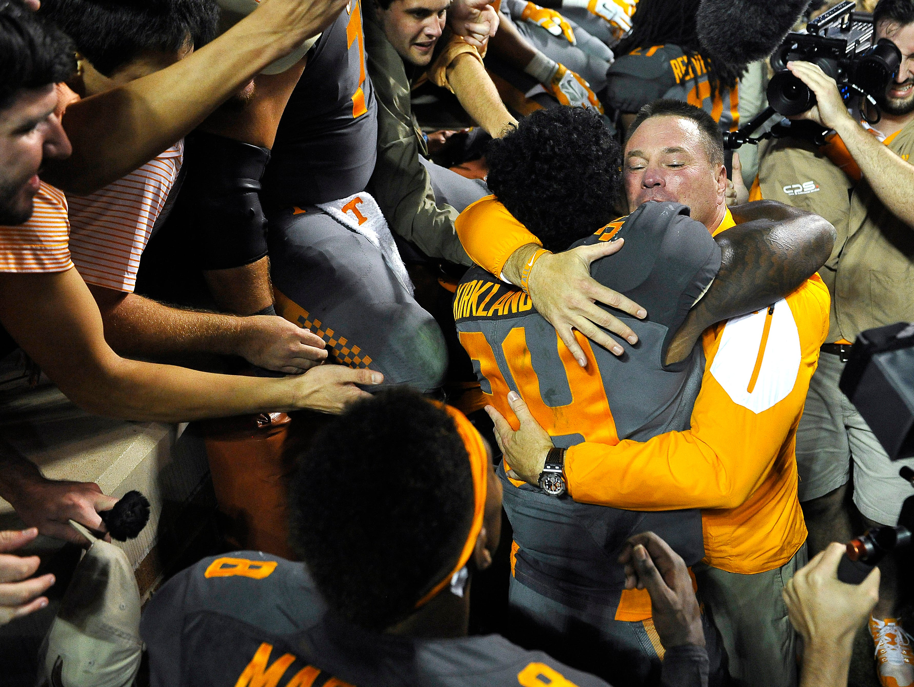 Tennessee coach Butch Jones hugs linebacker Darrin Kirkland Jr. (34) after the University of Tennessee beat Georgia 38-31 Saturday Oct. 10, 2015, in Knoxville, Tenn.