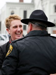 Amy Taft laughs Friday as she is greeted by Steuben
