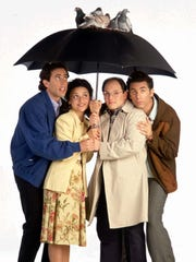 """Jerry Seinfeld, Julia Louis-Dreyfus, Jason Alexander and Michael Richards pose for an ad for """"Seinfeld."""""""