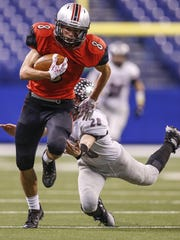 Cardinal Ritter's Brad Bacon (8) slips a would be tackle by Eastbrook PanthersÕ Edward Keasling (28) in the Class 2A state title game at Lucas Oil Stadium on Friday, Nov. 25, 2016.
