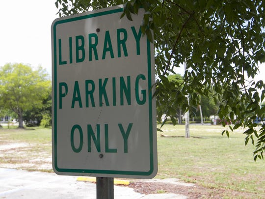 The library parking sign still stands in the parking lot where the library used to be in downtown Fort Myers.