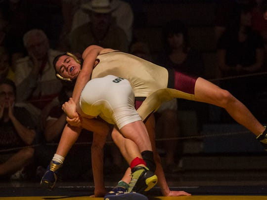 James Monos of Riverdale and Rocco Pereira wrestle in the Region 2A-3 Tournament on Saturday at Charlotte High School in Punta Gorda. Monos won the match.