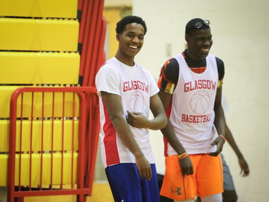Glasgow High School junior Kasai Guthrie (left) jokes with a teammate during basketball practice Wednesday.