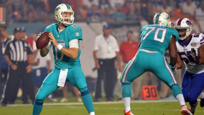 Miami Dolphins quarterback Ryan Tannehill (17) throws a pass against the Buffalo Bills during the first quarter at Sun Life Stadium.