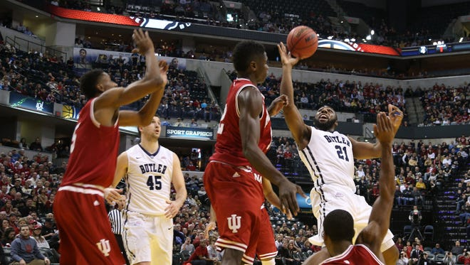 Butler Bulldogs forward Roosevelt Jones (21) takes a shot and is fouled by Indiana Hoosiers guard Robert Johnson (4) at Bankers Life Fieldhouse.