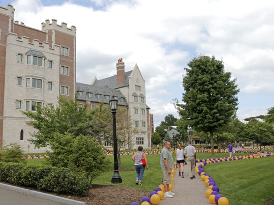 Elmira College was festooned with gold and purple balloons as students moved in for the fall semester in 2014. The college's annual economic impact is estimated at $136 million.