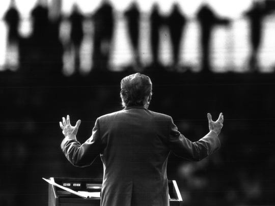 1988 - ROCHESTER: The Rev. Billy Graham gives his sermon to a capacity crowd at Silver Stadium.
