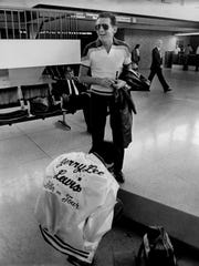 April 7, 1982 - Jerry Lee Lewis with bass player, Randy Wilkes, at Memphis International Airport prior to departing for a European tour that will include stops in London, Berlin, Zurich,  Rotterdam, Stockholm among other cities. The tour is to conclude on April 19.