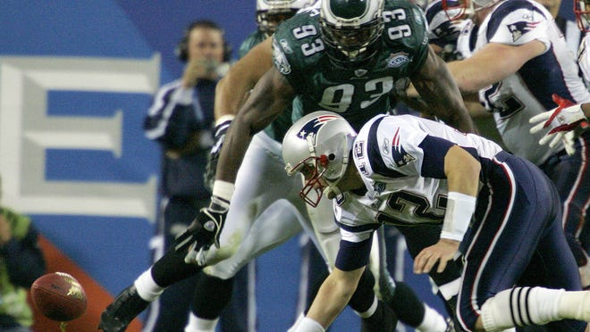 Feb. 6, 2005: Patriots quarterback Tom Brady fumbles the ball as Eagles defensive end Jevon Kearse moves in during the second quarter of Super Bowl XXXIX at Alltel Stadium in Jacksonville, Fla. The two teams meet in Super Bowl LII on Sunday in Minnesota.