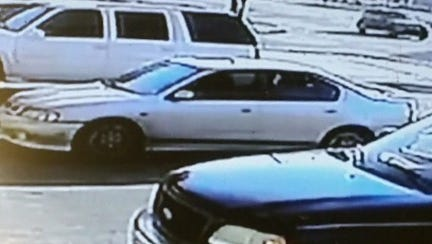 Video surveillance photo of the suspected car, a Nissan Sentra.