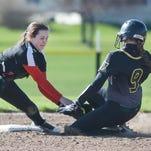 Prep Softball: South hangs on for win