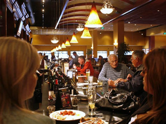 Patrons enjoy drinks at the bar at Bentley's Grill on Tuesday, April 20, 2010.