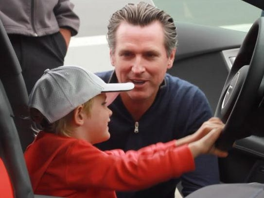 Calif. Lt. Gov. Gavin Newsom is shown with his son