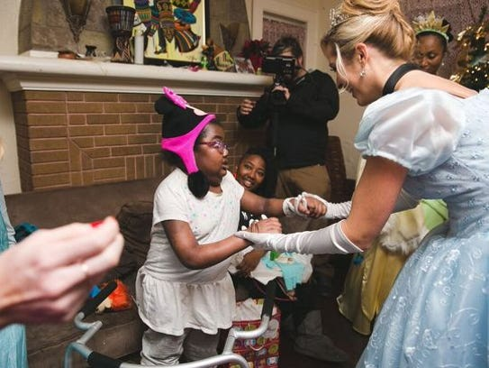 Princesses and superheroes helped surprise two children