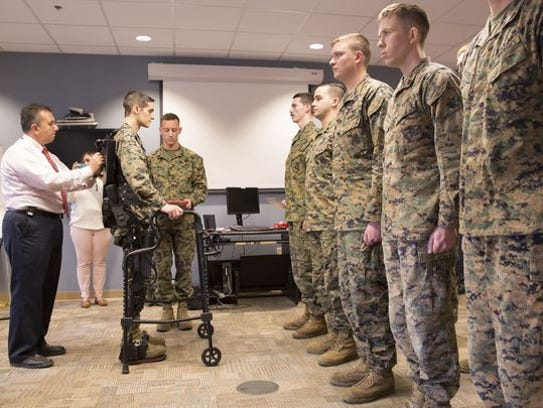 Joshua Burch is able to walk and stand at his promotion