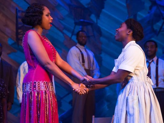 Jennifer Hudson, left, and Cynthia Erivo perform in