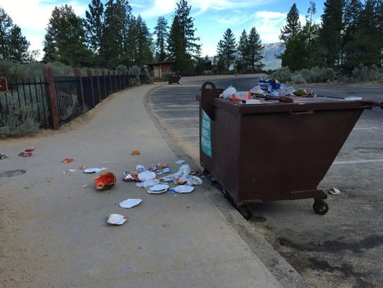 Trash left on and around a trash bin at Lake Tahoe