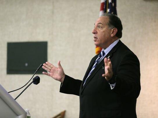 Morris County Prosecutor Fredric M. Knapp speaks at