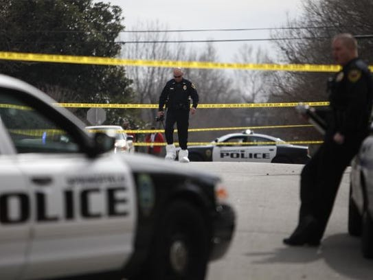 Springfield police at the scene of a double homicide