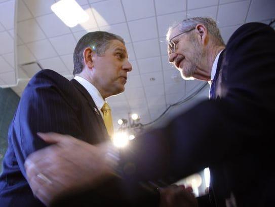 Lansing Mayor Virg Bernero and David Hollister, a former