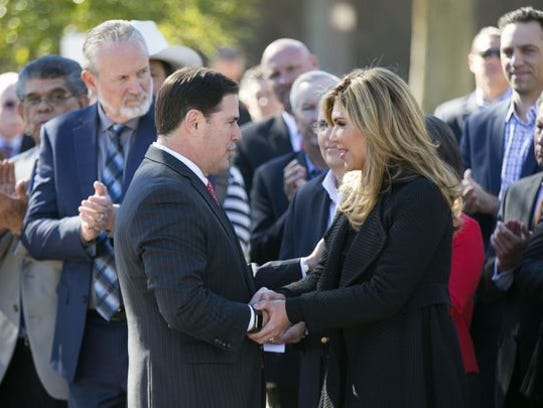 Arizona Gov. Doug Ducey shakes hands with Sonora, Mexico,